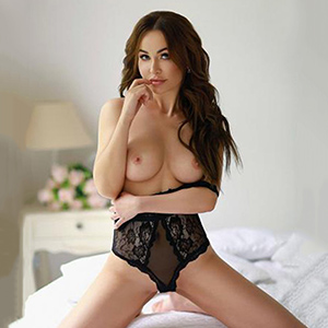 Young woman Esma Hot on the single search for strap-on dildo service in the Berlin escort agency